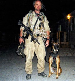 James (Founder) pictured with K9 Spike. Our logo was formed from this photo.