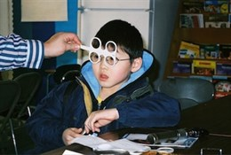 A child getting examined for his New Eyes glasses