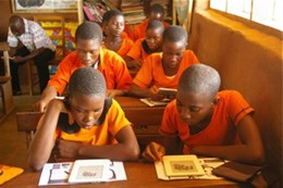 Ayenyah, Ghana primary-school students reading Curious George